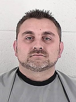 A math and science teacher from a Lenexa Catholic school has been with criminal sodomy and electronic solicitation of a 16-year-old.