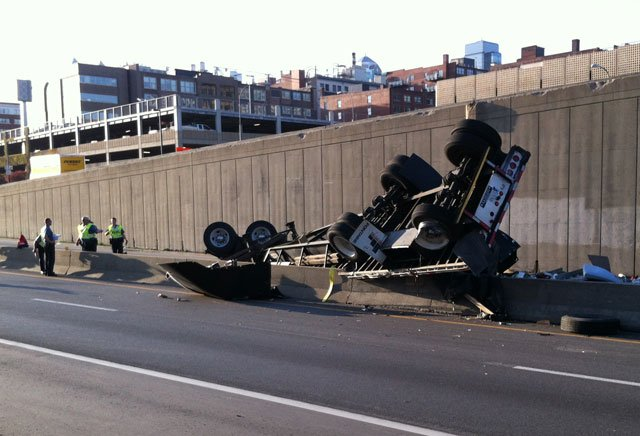 The accident happened just after 6:30 a.m. when the semi rolled off the northbound I-35 ramp to the Broadway exit.