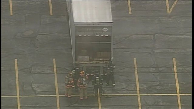 A UPS tractor trailer, carrying some kind of corrosive material, began smoking shortly before 7:30 a.m. Thursday.