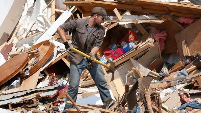 A metro church's mission team was ready to lend a hand in Moore, OK, but was told to stay home.  That is the message Church of the Resurrection got from Kansas and Oklahoma disaster response coordinators.  (AP)