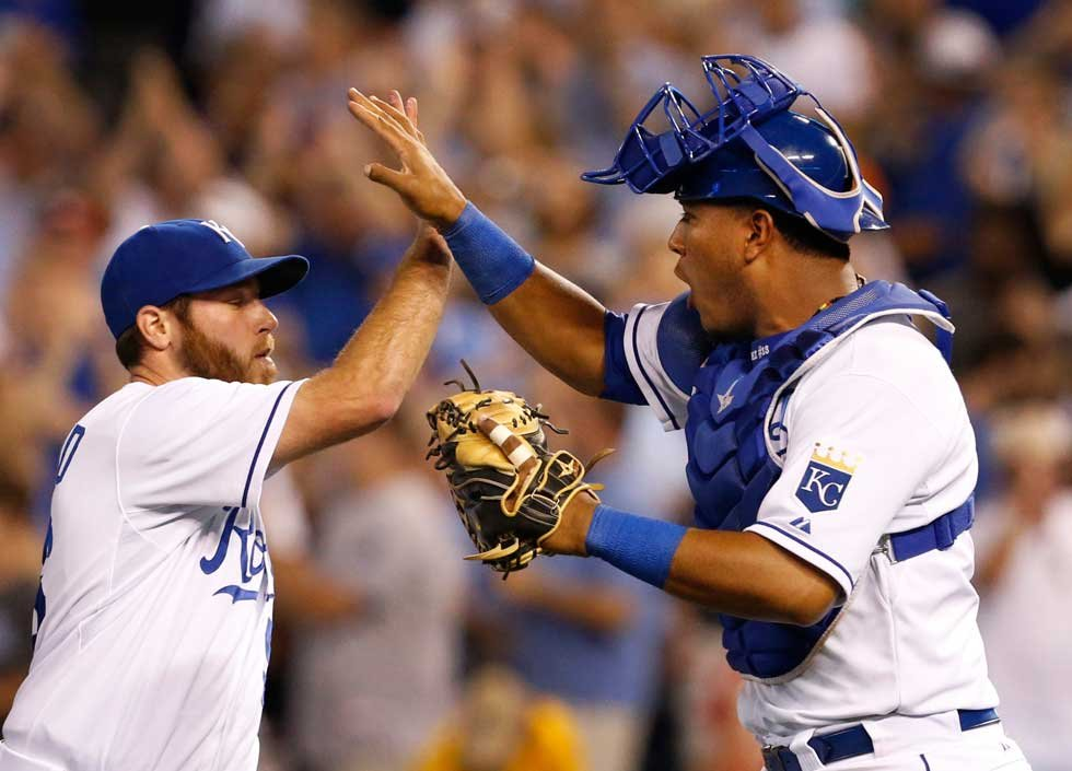 Kansas City Royals relief pitcher Greg Holland, left, celebrates with catcher Salvador Perez, right, following a baseball game against the Detroit Tigers at Kauffman Stadium Monday night.The Royals defeated the Tigers 3-2.  (AP)
