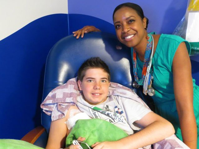 Nick LeGrande will deliver the pitch at Wednesday's Oakland A's-New York Yankees game from his hometown.  Dr. Jaszianne Tolbert, right, will be by his side to cheer him on. (Children's Mercy Hospital)