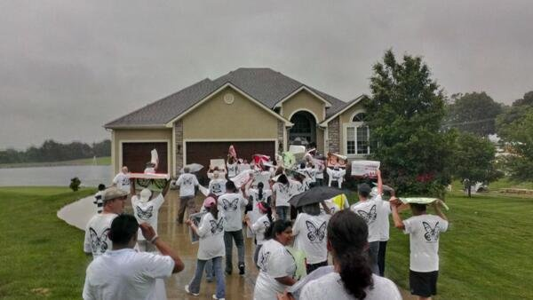Protesters outside Kris Kobach's home
