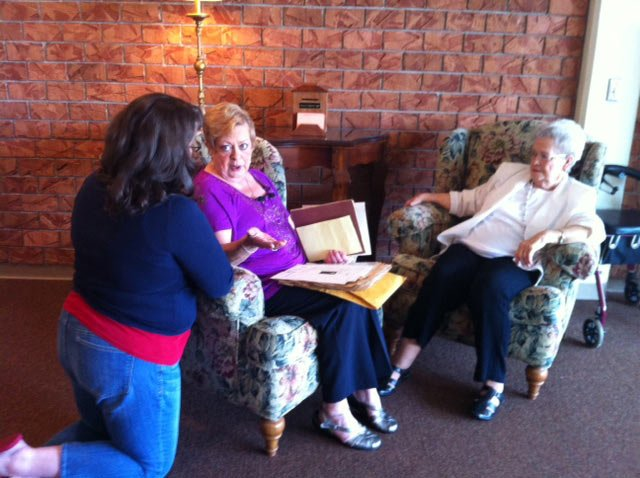A WSFA employee talks with Georgeann Troglin and Betty Cummins