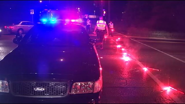 A large portion of U.S. Highway 71 near Brush Creek was shut down early Tuesday morning after three shooting suspects, fleeing police, crashed their car.