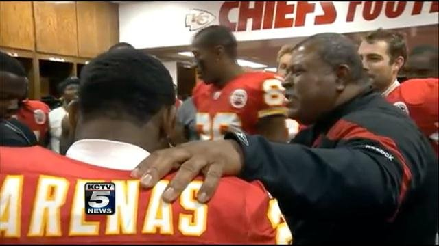 Former coach Romeo Crennel in the locker room with players