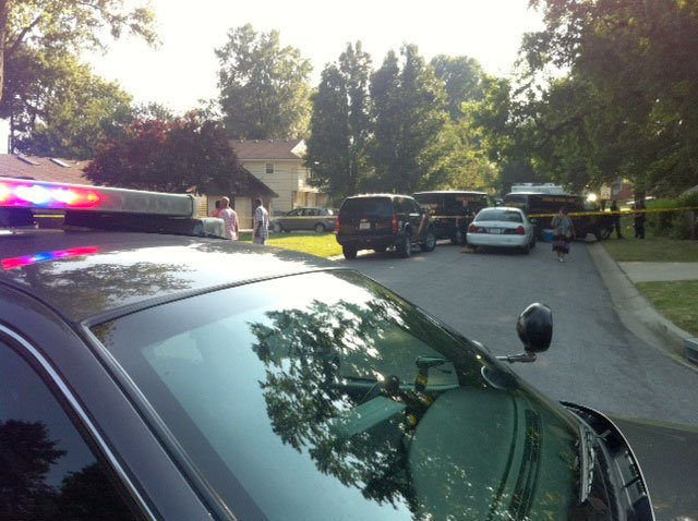 Police said the suspects pulled up outside the Thomas' house on 94th Terrace near Lamar Avenue about 3:30 p.m. Sunday.