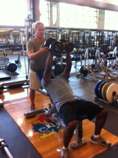 Sgt. Michael Pride trains with KU strength and conditioning coach Andrea Hudy.