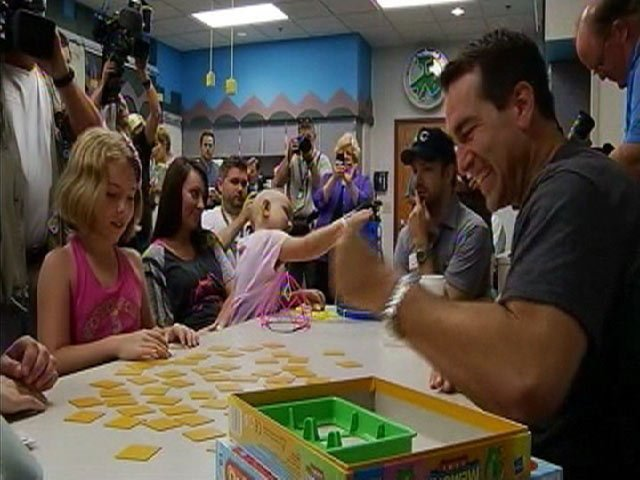 Actors and comedians Rob Riggle and Jason Sudeikis are seen playing games with kids at Children's Mercy Hospital last year.