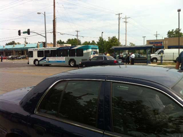 At least one person was taken into custody after a gunman opened fire on ATA bus