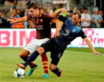 (AP Photo/Charlie Riedel). AS Roma midfielder Kevin Strootman, left, and MLS All-Stars midfielder Brad Davis battle for the ball during the first half of the MLS All-Star soccer game Wednesday, July 31, 2013, in Kansas City, Kan.