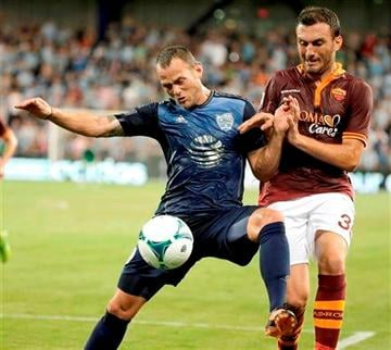 (AP Photo/Charlie Riedel). AS Roma defender Vasilis Torosidis, right, and MLS All-Stars midfielder Brad Davis battle for the ball during the first half of the MLS All-Star soccer game Wednesday, July 31, 2013, in Kansas City, Kan.
