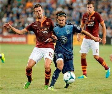 (AP Photo/Charlie Riedel). AS Roma midfielder Miralem Pjanic (15) and MLS All-Stars forward Graham Zusi (8) battle for the ball during the first half of the MLS All-Star soccer game Wednesday, July 31, 2013, in Kansas City, Kan.
