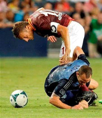 (AP Photo/Charlie Riedel). AS Roma forward Francesco Totti, top, and MLS All-Stars midfielder Brad Davis battle for the ball during the first half of the MLS All-Star soccer game Wednesday, July 31, 2013, in Kansas City, Kan.
