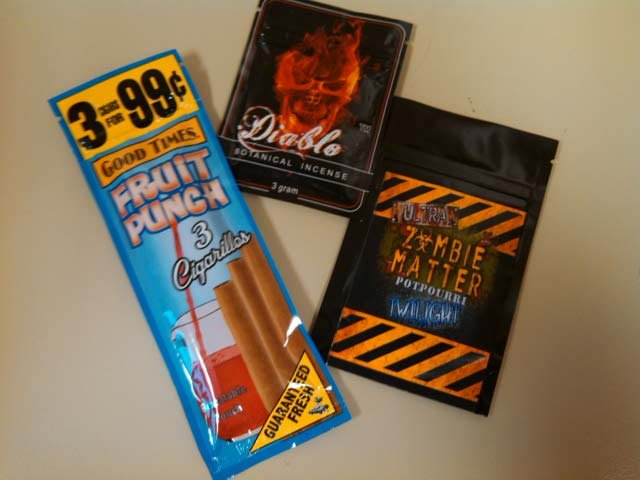 "From Bill Hisle with the Shawnee Police Department: You will see in the pictures a flavored ""cigarillo"" type product.  That is given to the buyer to who then opens up the cigarillo (flavored cigarette) sprinkles the K2 into it, re-wraps, then smokes it."