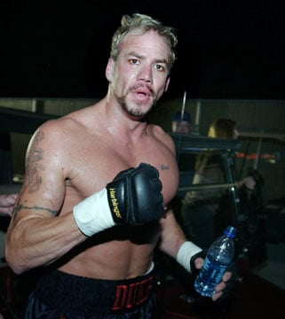 Former world heavyweight champion boxer Tommy Morrison strikes a pose after defeating John Stover in Morrison's mixed martial arts fighting debut in Camp Verde, Ariz., Saturday, June 9, 2007. (AP Photo/Tom Hood)