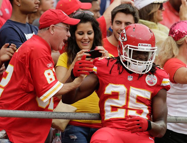 Kansas City Chiefs running back Jamaal Charles (25) celebrates a touchdown with fans during the first half of an NFL football game against the Dallas Cowboys at Arrowhead Stadium in Kansas City, Mo., Sunday, Sept. 15, 2013. (AP Photo/Charlie Riedel)