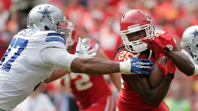 Kansas City Chiefs running back Jamaal Charles (25) avoids Dallas Cowboys defensive tackle Jason Hatcher (97) during the first half of an NFL football game at Arrowhead Stadium in Kansas City, Mo., Sunday, Sept. 15, 2013. (AP Photo/Charlie Riedel)