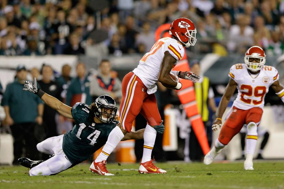 Kansas City Chiefs' Sean Smith, center, returns an interception as Philadelphia Eagles' Riley Cooper defends during the first half of an NFL football game Thursday. (AP Photo/Matt Rourke)