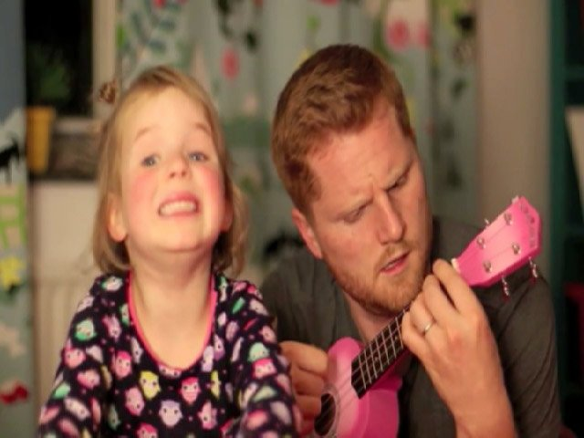 "To help soothe little Adeline down, her father grabbed a ukulele and the two began singing ""Tonight You Belong to Me""."