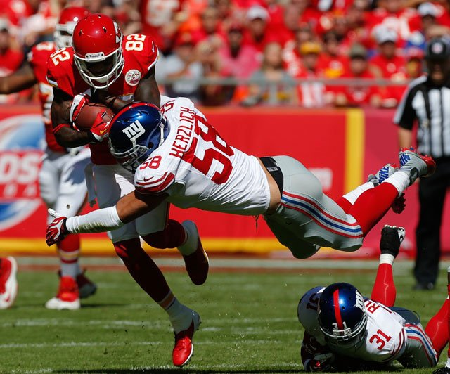 Kansas City Chiefs wide receiver Dwayne Bowe (82) is tackled by New York Giants middle linebacker Mark Herzlich (58) during the first half of an NFL football game at Arrowhead Stadium in Kansas City, Mo., Sunday, Sept. 29, 2013. (AP Photo/Ed Zurga)