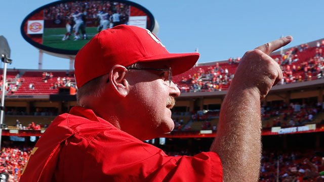 Kansas City Chiefs coach Andy Reid point to the stands following an NFL football game against the New York Giants at Arrowhead Stadium in Kansas City, Mo., Sunday, Sept. 29, 2013. The Chiefs defeated the Giants 31-7. (AP Photo/Ed Zurga)