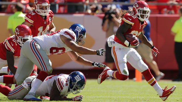 Kansas City Chiefs kick returner Dexter McCluster (22) breaks past New York Giants defenders Justin Trattou (69) and Mathias Kiwanuka (94) for a touchdown during the second half of an NFL football game at Arrowhead Stadium. (AP Photo/Charlie Riedel)