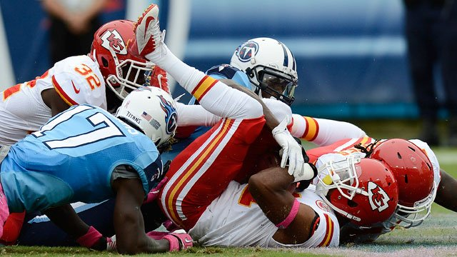 Kansas City Chiefs cornerback Marcus Cooper, front right, recovers a Tennessee Titans fumble in the end zone for a touchdown in the first quarter of an NFL football game on Sunday, Oct. 6, 2013, in Nashville, Tenn. (AP Photo/Mark Humphrey)