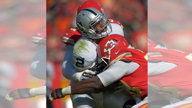 Oakland Raiders quarterback Terrelle Pryor (2) is sacked by Kansas City Chiefs outside linebackers Justin Houston (50) and Tamba Hali (91) during the second half of an NFL football game at Arrowhead Stadium in Kansas City.  (AP Photo/Reed Hoffmann)