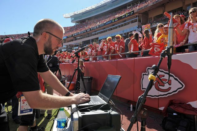 Zach Aaron of Reliant Media Systems monitors sound levels as the Kansas Chiefs fans try for a world record for loudest stadium during the first half of their NFL football game against the Oakland Raiders at Arrowhead Stadium. (AP Photo/Reed Hoffmann)