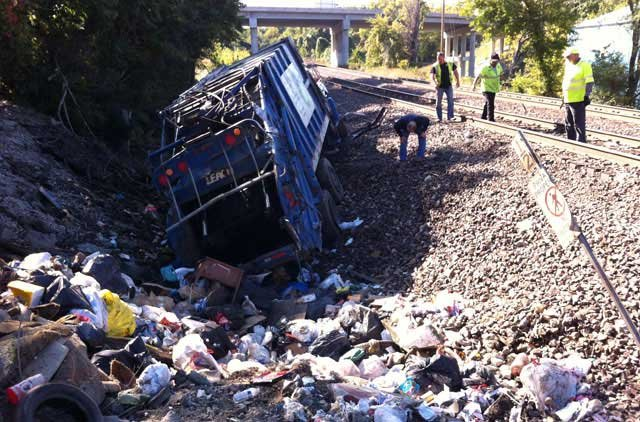 The driver of a trash truck was injured after a loaded Amtrak passenger train slammed into it Thursday morning. (Chuck Prewitt/KCTV5)