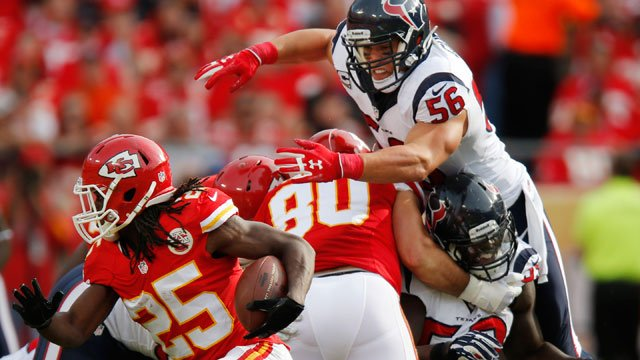 Houston Texans inside linebacker Brian Cushing (56) dives over blockers going after Kansas City Chiefs running back Jamaal Charles (25) during the first half of an NFL football game at Arrowhead Stadium in Kansas City, Mo. (AP Photo/Ed Zurga)