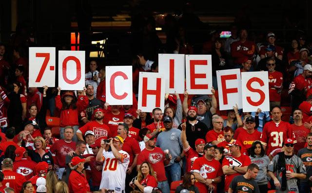 Kansas City Chiefs fans hold up the teams record following an NFL football game against the Houston Texans at Arrowhead Stadium in Kansas City, Mo., Sunday, Oct. 20, 2013. The Chiefs defeated the Texans 17-16. (AP Photo/Ed Zurga)