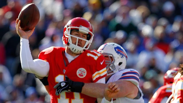 Kansas City Chiefs quarterback Alex Smith (11) is hit by Buffalo Bills defensive tackle Kyle Williams (95) during the first quarter of an NFL football game in Orchard Park, N.Y. Sunday, Nov. 3, 2013. (AP Photo/ Bill Wippert)