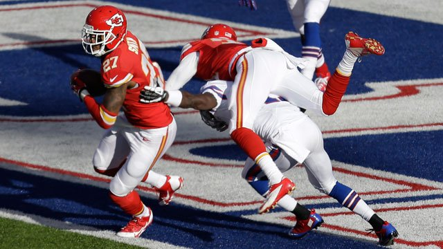 Kansas City Chiefs cornerback Sean Smith (27) intercepts a pass intended for Buffalo Bills wide receiver T.J. Graham (11) who is tackled by Marcus Cooper (31) in the endzone and returns it for a touchdown during the third quarter. (AP Photo/Gary Wiepert)
