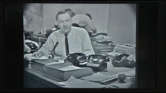 Walter Cronkite at the CBS Evening News anchor desk