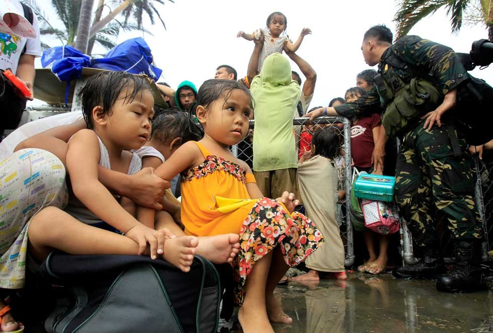 Children, women prioritized for flights after typhoon devastates Philippines (A)
