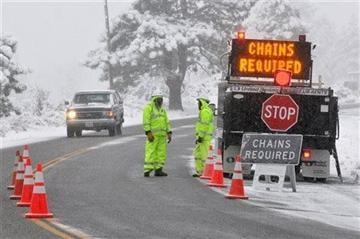 (AP Photo/The Victor Valley Daily Press, David Pardo). Caltrans set a up a chains required station just south of Mountain High Resort in Wrightwood, Calif, on Friday, Nov 22, 2013.