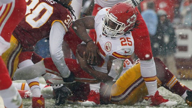 Kansas City Chiefs running back Jamaal Charles gets by Washington Redskins free safety E.J. Biggers (30) and carries the ball into the end zone for a touchdown during the first half in Landover, Md., Sunday, Dec. 8, 2013. (AP Photo/Evan Vucci)
