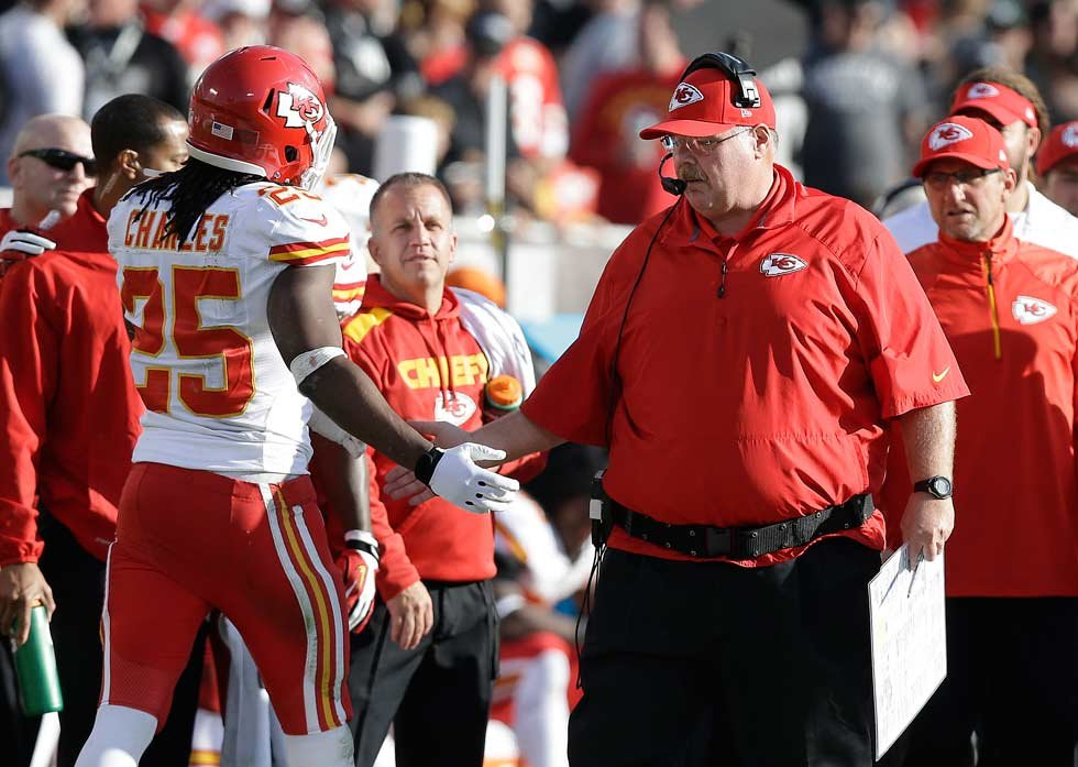 Kansas City Chiefs head coach Andy Reid, left, greets running back Jamaal Charles (25) on the sideline during the second quarter of an NFL football game against the Oakland Raiders in Oakland, Calif., Sunday, Dec. 15, 2013. (AP Photo/Marcio Jose Sanchez)