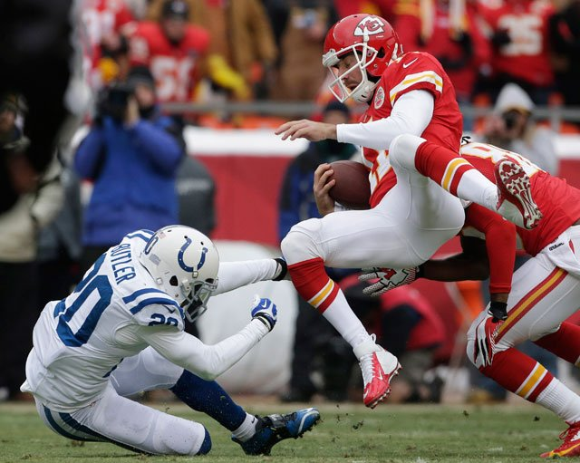 Kansas City Chiefs quarterback Alex Smith (11) is knocked down by Indianapolis Colts free safety Darius Butler (20) during the first half of an NFL football game at Arrowhead Stadium in Kansas City, Mo., Sunday, Dec. 22, 2013. (AP Photo/Charlie Riedel)