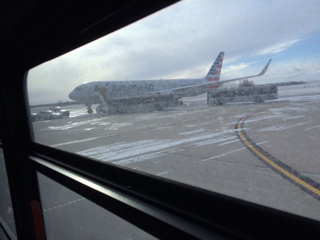 American Airlines flight 24 was heading from San Francisco to New York.  The plane had to land at KCI about 2 p.m. Sunday because authorities found a flash drive left in the plane's lavatory.