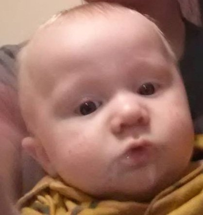 Authorities say the infant, Mitchell Farris, was found with his parents Sunday in Miami.