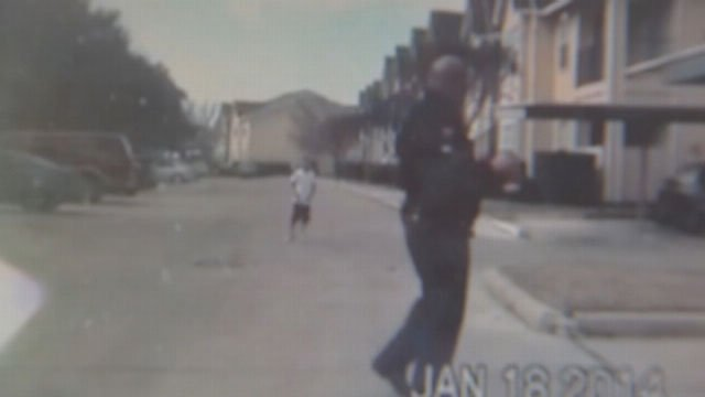 If you have seen the video of an officer tossing a football with a little boy he didn't know at an apartment complex in Rosenberg, you're one of about a million. (KTRK via CNN)