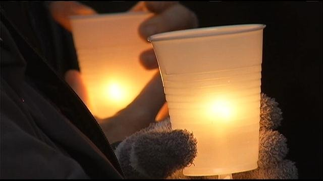 A vigil was held Sunday evening for two families that had a loved one murdered more than 20 years ago, both cases without a conviction, but the families believe the murders are connected.