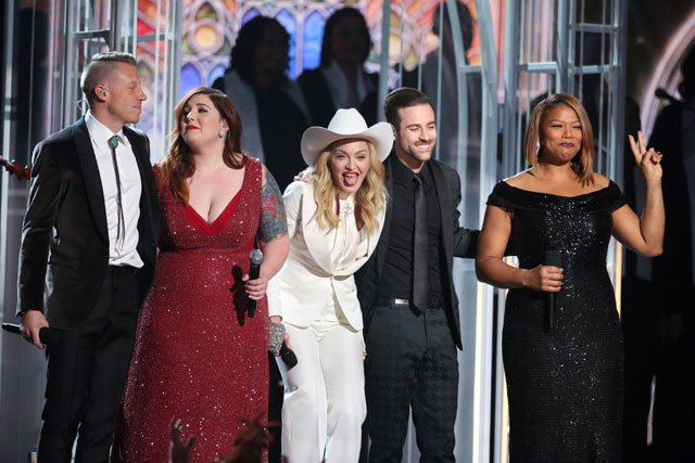 From left, Macklemore, Mary Lambert, Madonna, Ryan Lewis and Queen Latifah perform on stage at the 56th annual GRAMMY Awards at Staples Center on Sunday, Jan. 26, 2014, in Los Angeles. (Photo by Matt Sayles/Invision/AP)