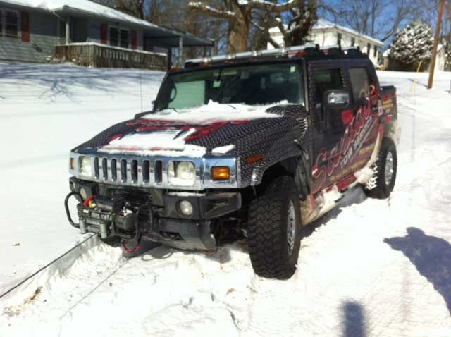 Santa Fe Towing uses Hummer to free vehicles that tow trucks can't get