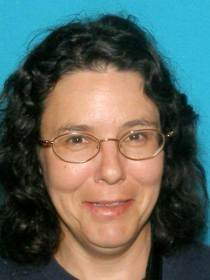 Officials say the body was that of 43-year-old Sandra Herron-Burns, who had been reported missing from a nearby apartment in December.