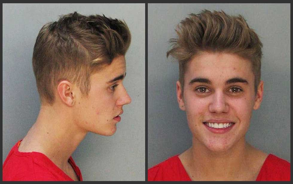 Justin Bieber mug shots after arrest in Miami in January 2014