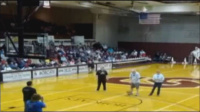Fans at a College of Ozarks basketball game cheered wildly Saturday when 54-year-old Michael Quin hit the shot. A video of the shot got attention on some social media sites during the weekend.